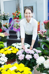 mature woman in  flower shop