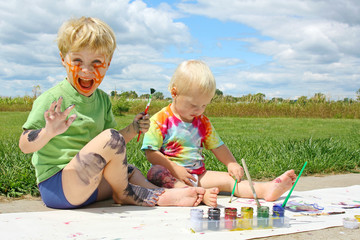 Messy Children Painting Outside