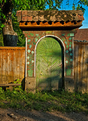 Typical old wooden carved gate in Transylvania, Romania