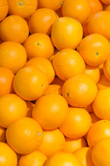 Lots of bright oranges in supermarket