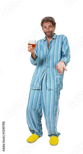 drunk man standing in pajamas with glass