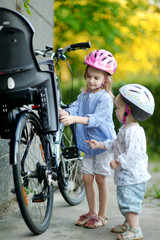 Two sisters going to have a bicycle ride