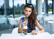 Attractive woman drinking iced coffee