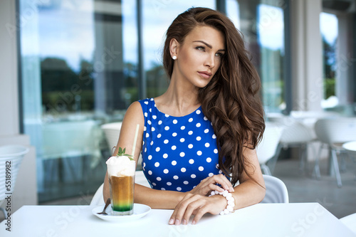 Young woman with iced coffee