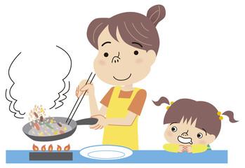 料理を作るお母さん見守る子供