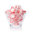 Peppermint candy in glass bowl isolated