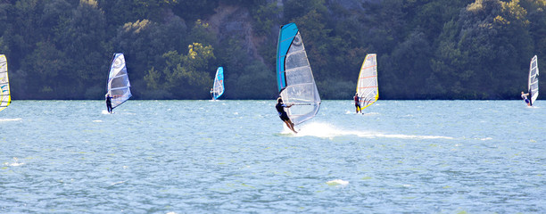 Windsurfer on Cavédine lake-Trento-color image