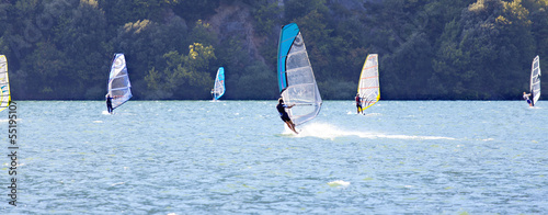 Windsurfer on Cavédine lake-Trento-color image