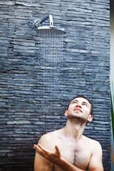 man washing in shower