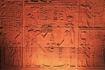 Ancient hieroglyphics on the wall of Philae Temple