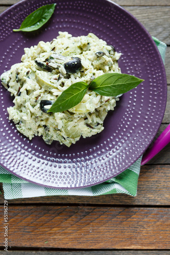 risotto with vegetables and basil, top view
