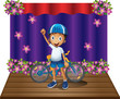 A boy and his bike at the center of the stage