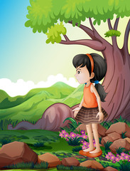 A cute little girl near the giant tree