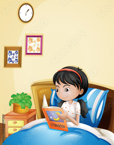 A young lady reading a storybook in her bed