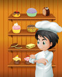 A chef in front of the baked goodies