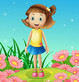 A cute little girl at the hilltop surrounded with flowers