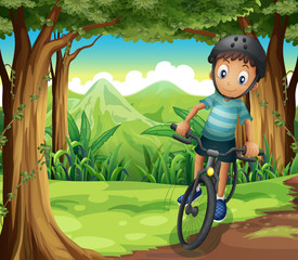 A boy biking in the middle of the forest