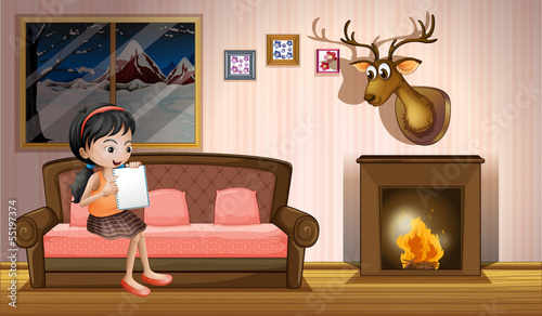A girl studying inside the house near the fireplace