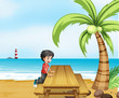 A boy at the beach with a wooden table near the coconut tree