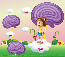 A girl above the cloud surrounded with spiral candies