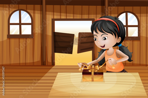 A girl unwrapping a gift above the table in the saloon bar