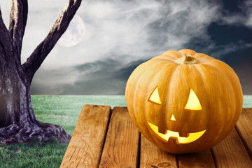 Halloween pumpkin over dramatic background