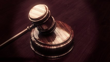 Judge gavel with lighted background looping animation