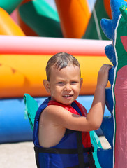 Kid in the swimming vest at a water park