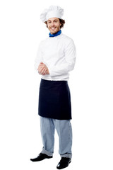 Handsome young cook posing in uniform