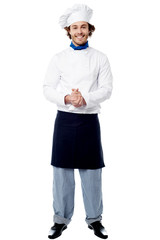 Full length portrait of a handsome chef