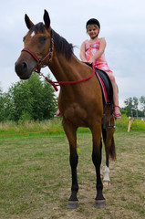 School girl on arabian horse