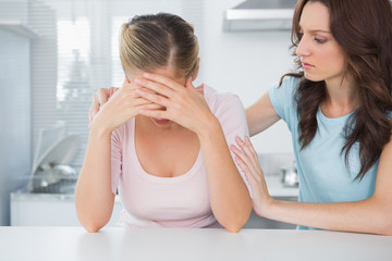 Woman looking at her overwhelmed friend
