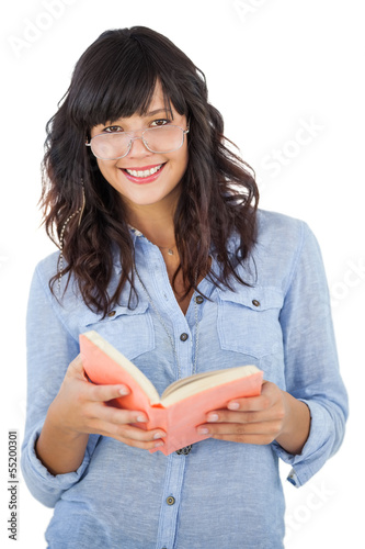 Young woman wearing glasses and holding book