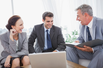 Business people laughing while having a meeting