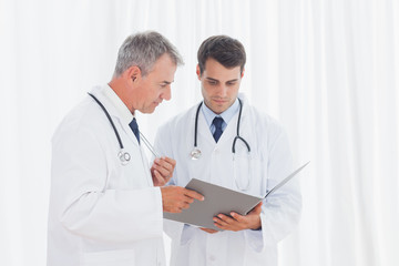 Doctors analyzing results together