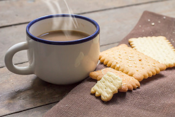 Hot coffee with crackers.