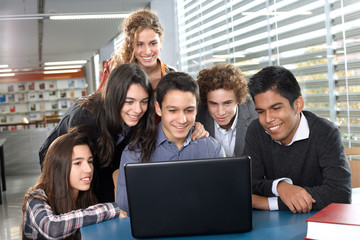 Group of teenagers with laptop