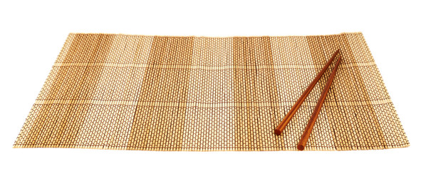 Chopsticks over a bamboo mat