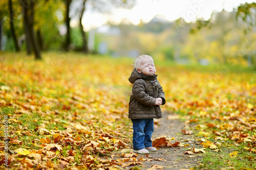 Adorable girl crying on beautiful autumn day