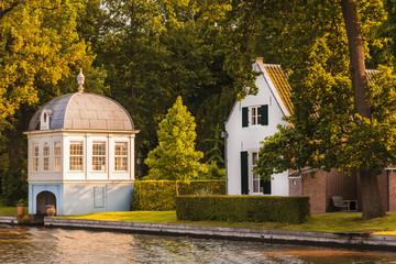 Old boathouse alongside the Dutch Vecht river