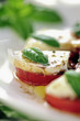 Fresh caprese salad with delicious tomatos + mozzarella and bas