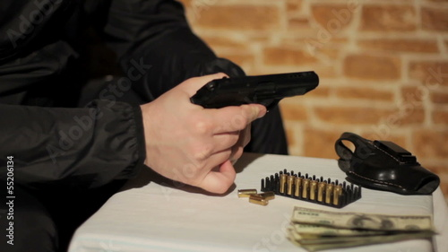 Man examines a gun