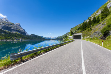 The road at the foot of Mount Marmolada - Italy.