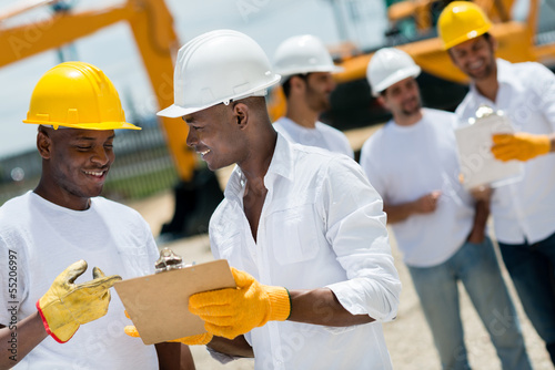 Architects working at a construction site