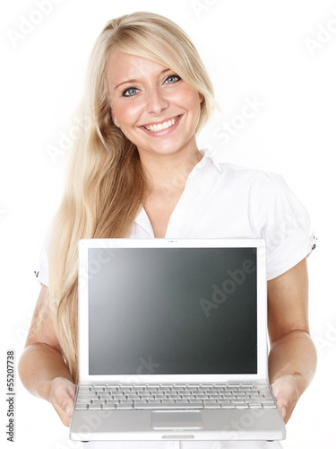 Business woman pointing at her laptop with copyspace