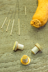 Akupunkturnadeln und Ginsengwurzel