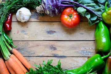Fresh vegetables on table background.