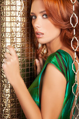 Beautiful red hair woman. Attractive young red hair woman lookin