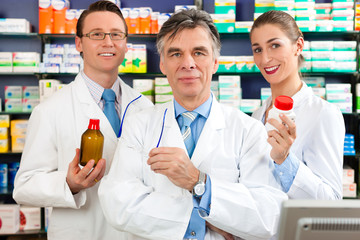 Team of pharmacists in pharmacy
