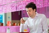 Young man in ice cream parlor poster